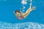 9760040-happy-smiling-underwater-kid-in-swimming-pool