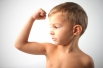 boy showing muscle shutterstock_62022709